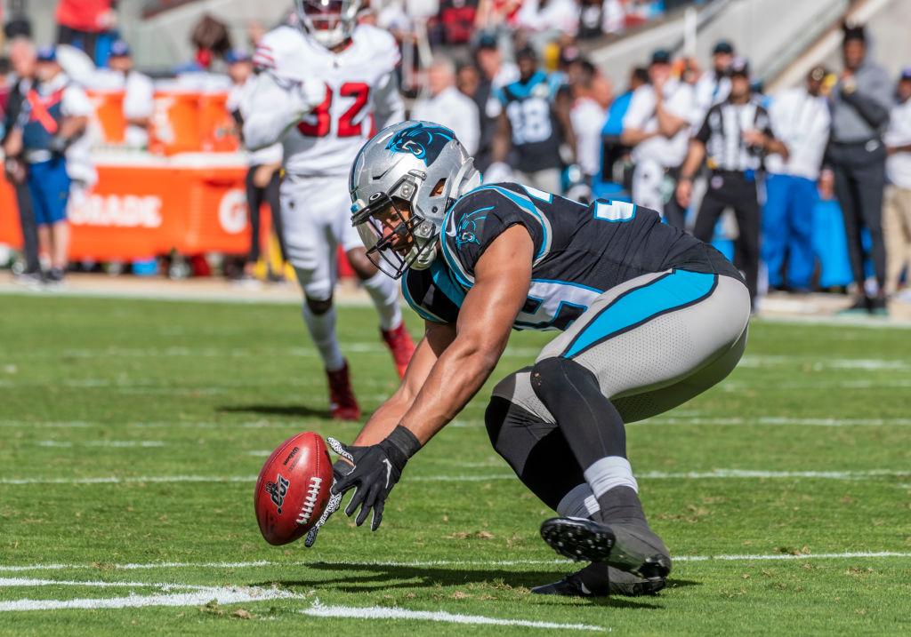 Carolina Panthers running back Reggie Bonnafon bobbles a kickoff return