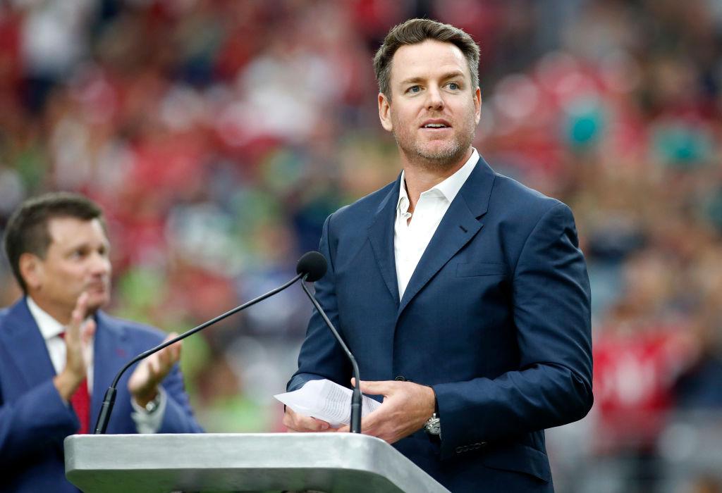 Former NFL quarterback Carson Palmer giving a speech.