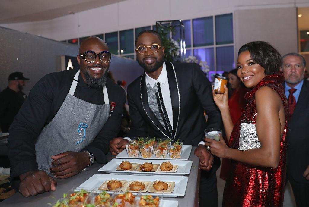 Chef Richard Ingraham, Dwyane Wade and Gabrielle Union attend a gala