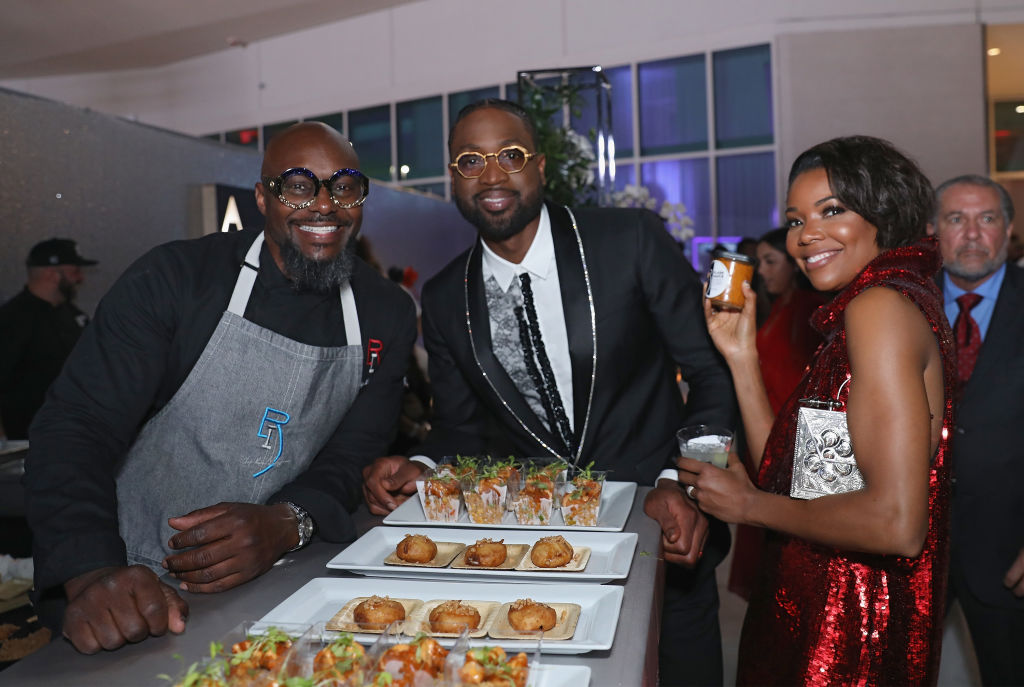 Chef Richard Ingraham, Dwyane Wade and Gabrielle Union attend a gala