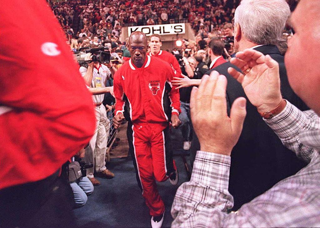 Chicago Bulls basketball star Michael Jordan runs onto the court