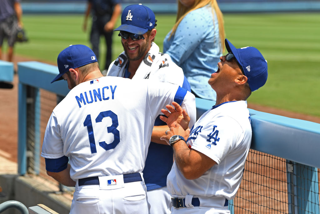 Dodgers manager Dave Roberts and players Clayton Kershaw and Max Muncy