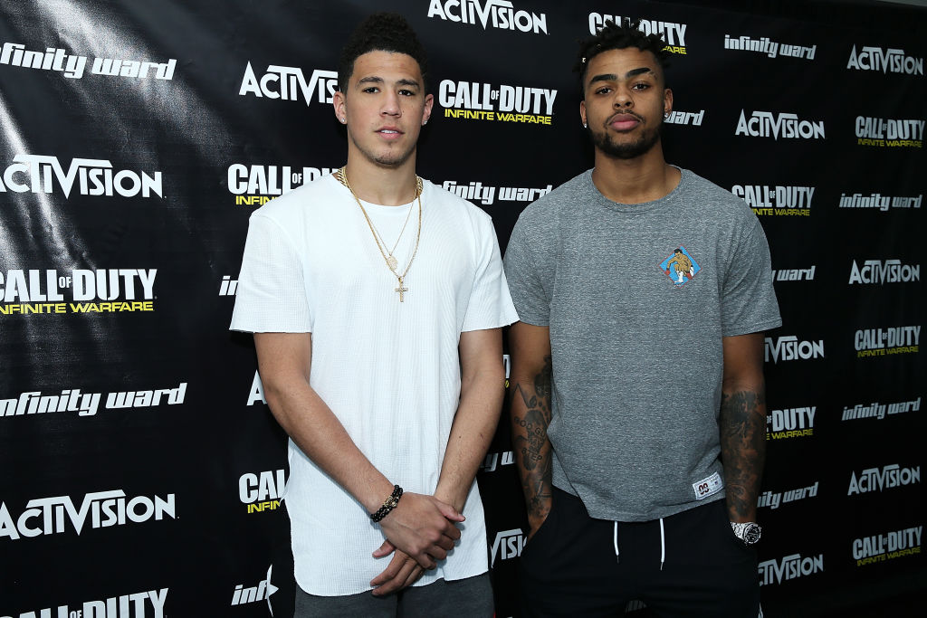 Warriors guard D'Angelo Russell and Suns guard Devin Booker
