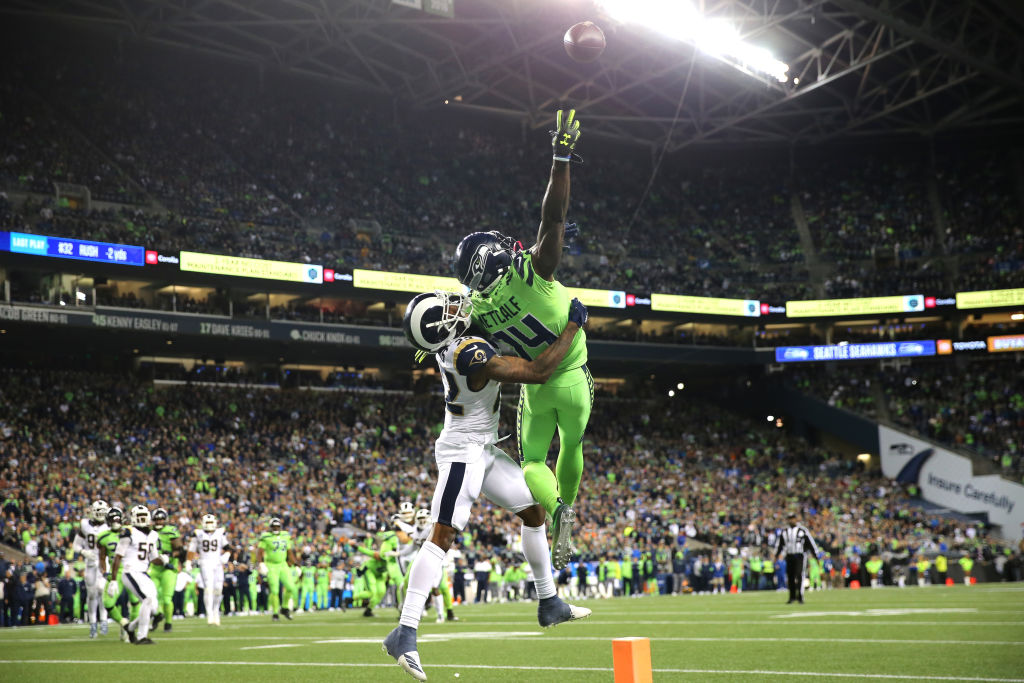 Seattle Seahawks receiver DK Metcalf uses his wingspan to reach for a Russell Wilson pass.