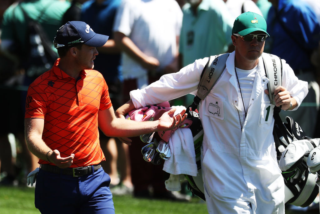 Danny Willett talks to his caddie Jonathan Smart during a practice round
