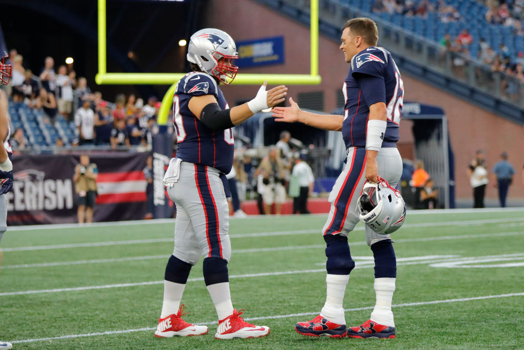New England Patriots center David Andrews greets quarterback Tom Brady