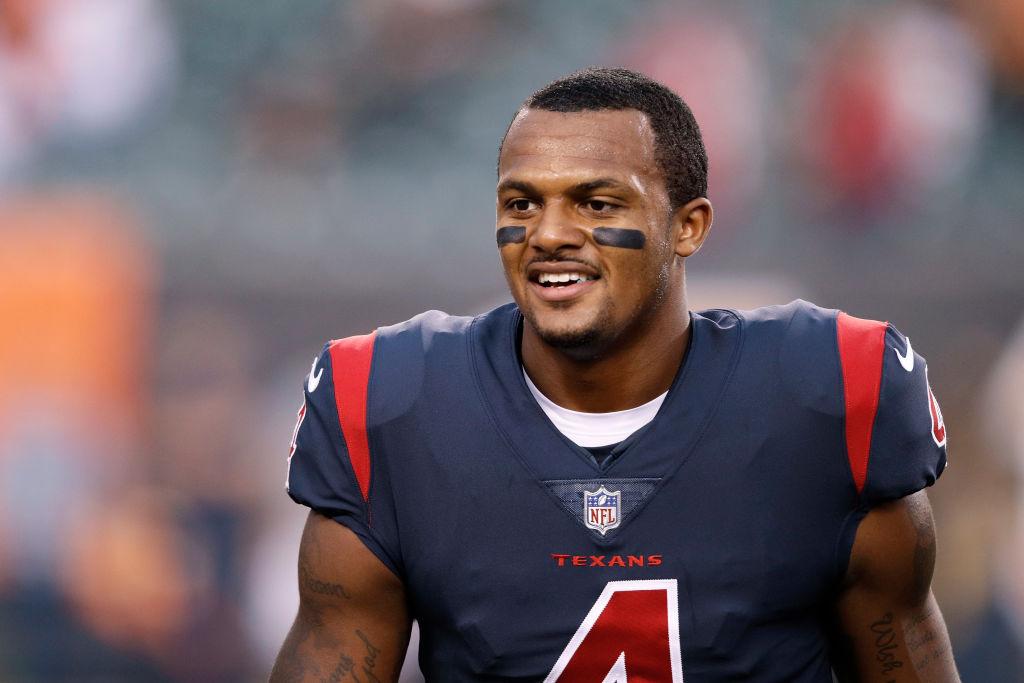 Texans' quarterbackDeshaun Watson smiles on the sideline