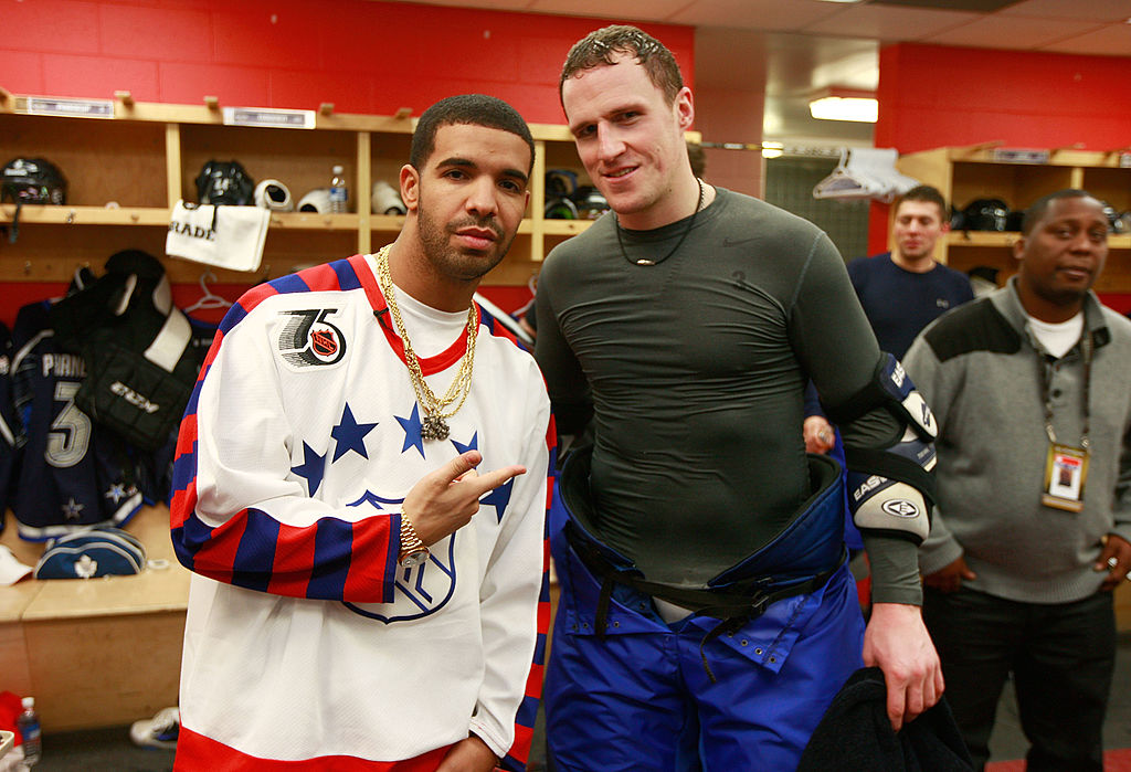 Rapper Drake visits Dion Phaneuf of the Toronto Maple Leafs in the locked room