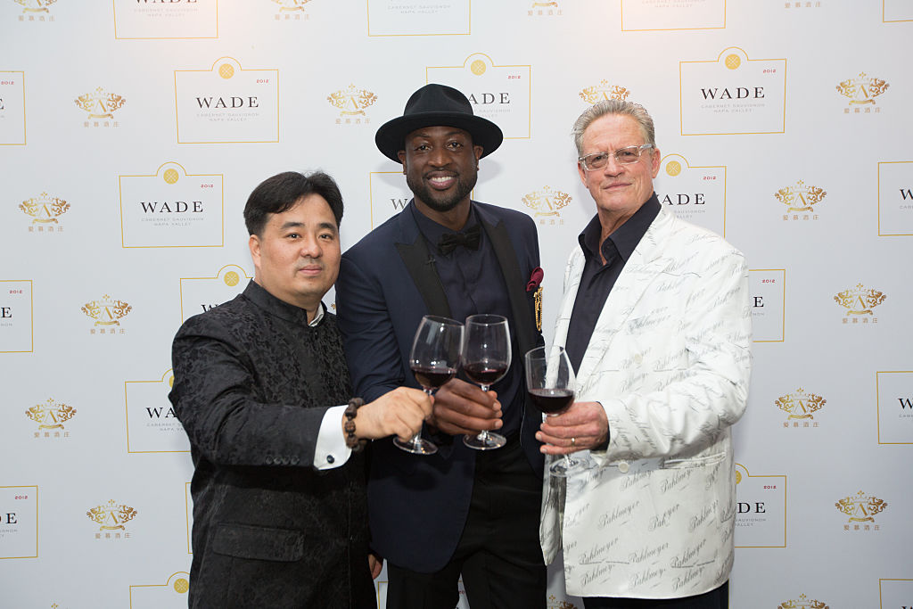 Nee Lau, Dwyane Wade and Jayson Pahlmeyer celebrate Wade's new wine label