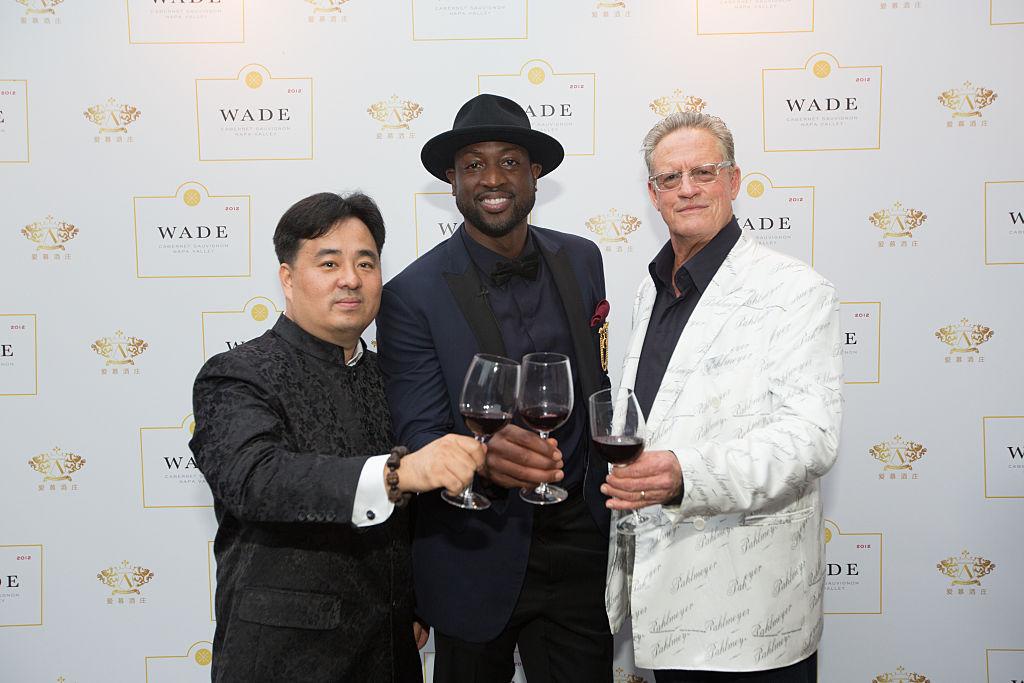 Nee Lau, Dwyane Wade and Jayson Pahlmeyer celebrate Wade's new wine label
