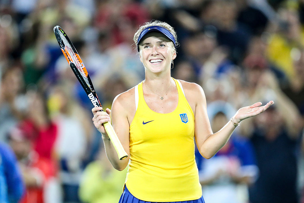 Elina Svitolina of Ukraine reacts after defeating Serena Williams