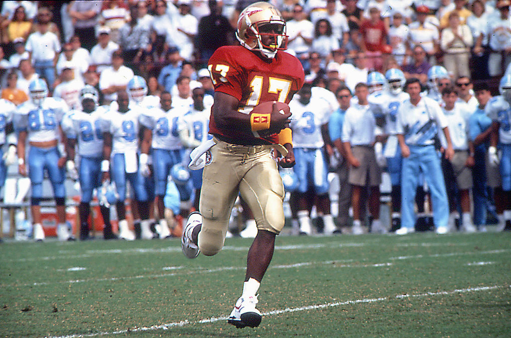 Charlie Ward of the Florida State Seminoles runs the ball downfield