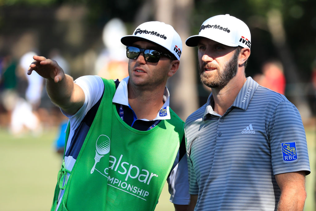 Dustin Johnson talks to his brother and caddie Austin Johnson
