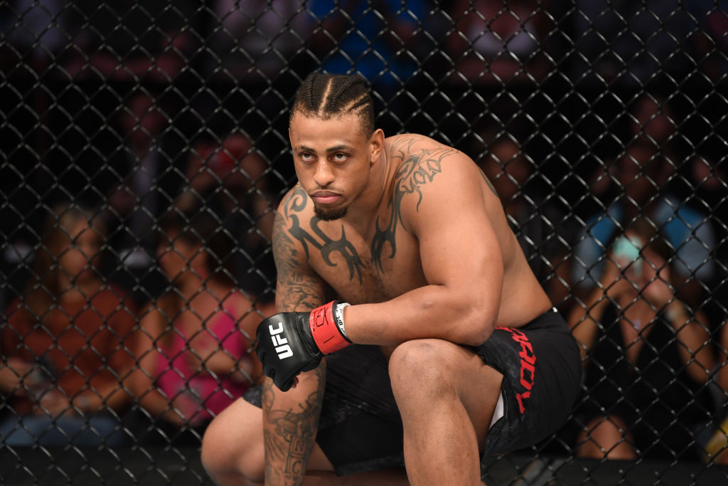 UFC fighter Greg Hardy waits in his corner between rounds.