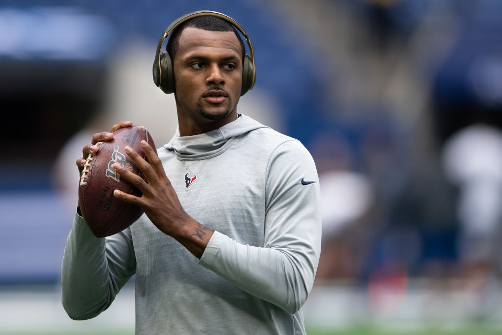 Houston Texans quarterback Deshaun Watson warms up on the field