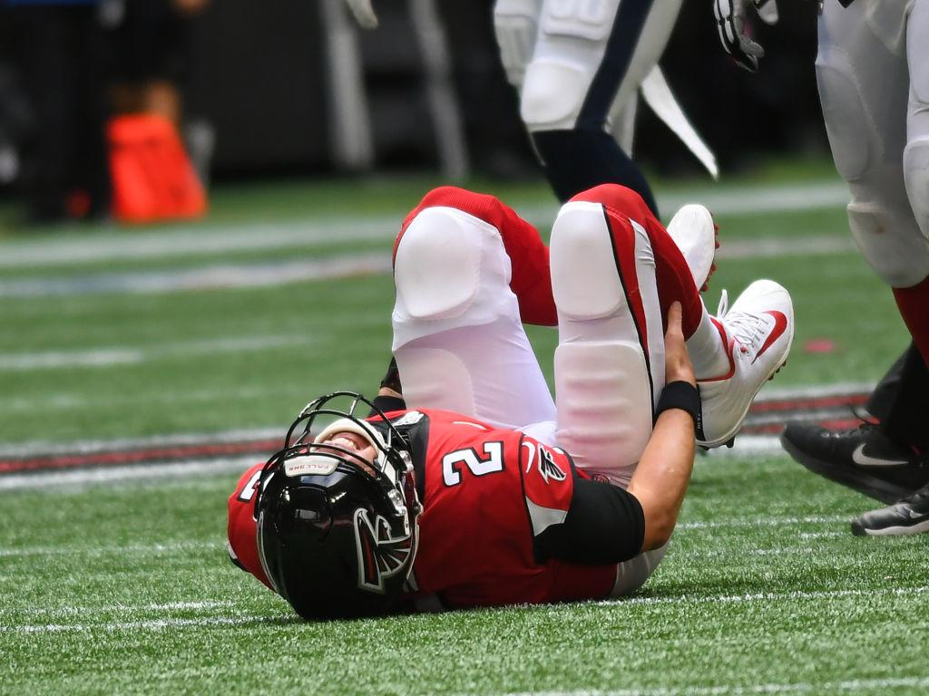 An injured Atlanta Falcons Quarterback Matt Ryan lays on the field