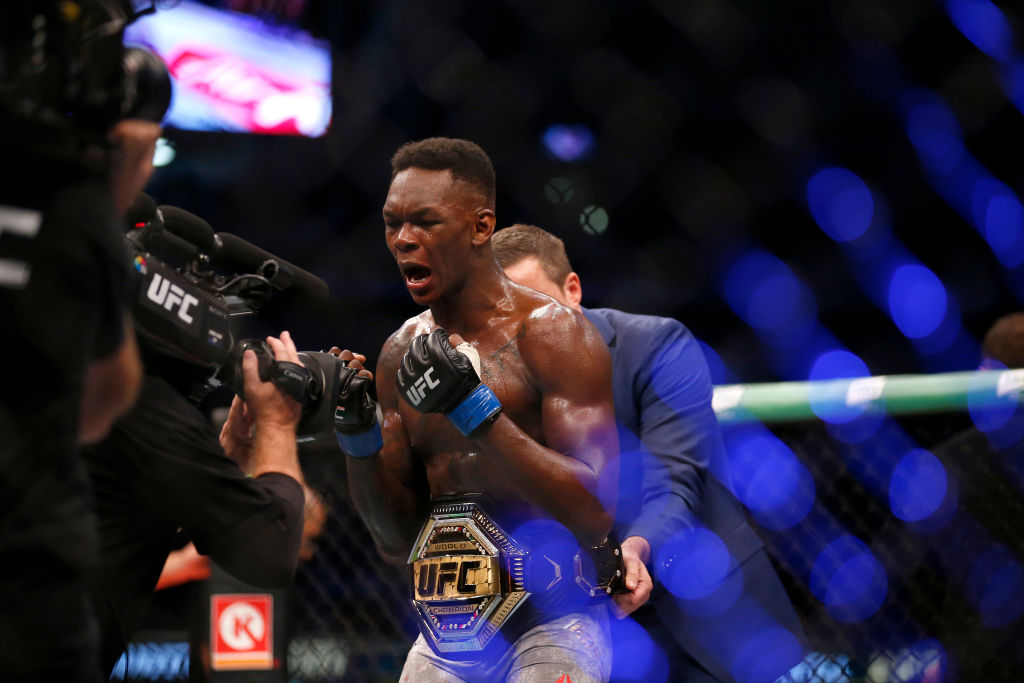 Israel Adesanya celebrates his victory over Robert Whittaker