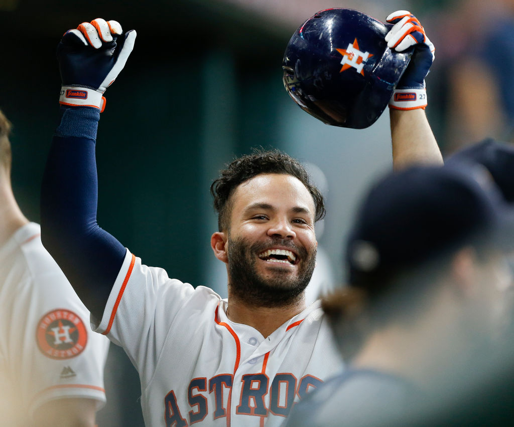 Houston Astros' second baseman Jose Altuve celebrating in the dugout.