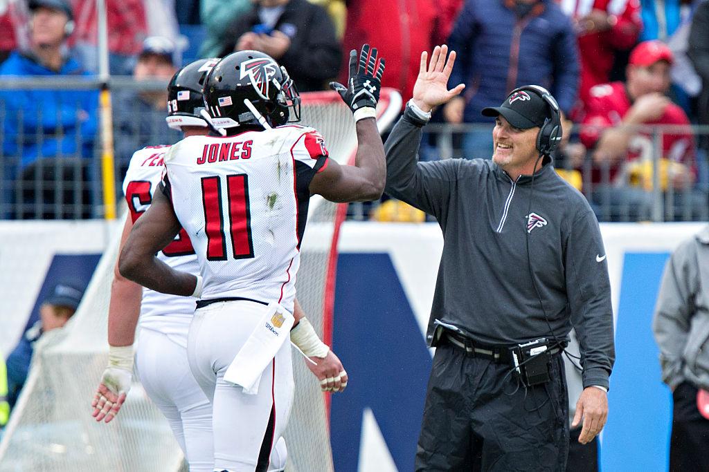 Julio Jones and Dan Quinn high-five on the sideline.