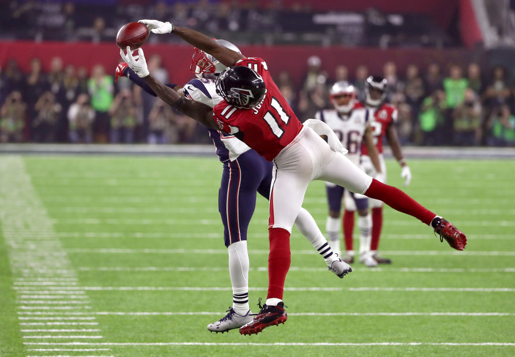 Falcons' receiver Julio Jones dives out to catch a ball.