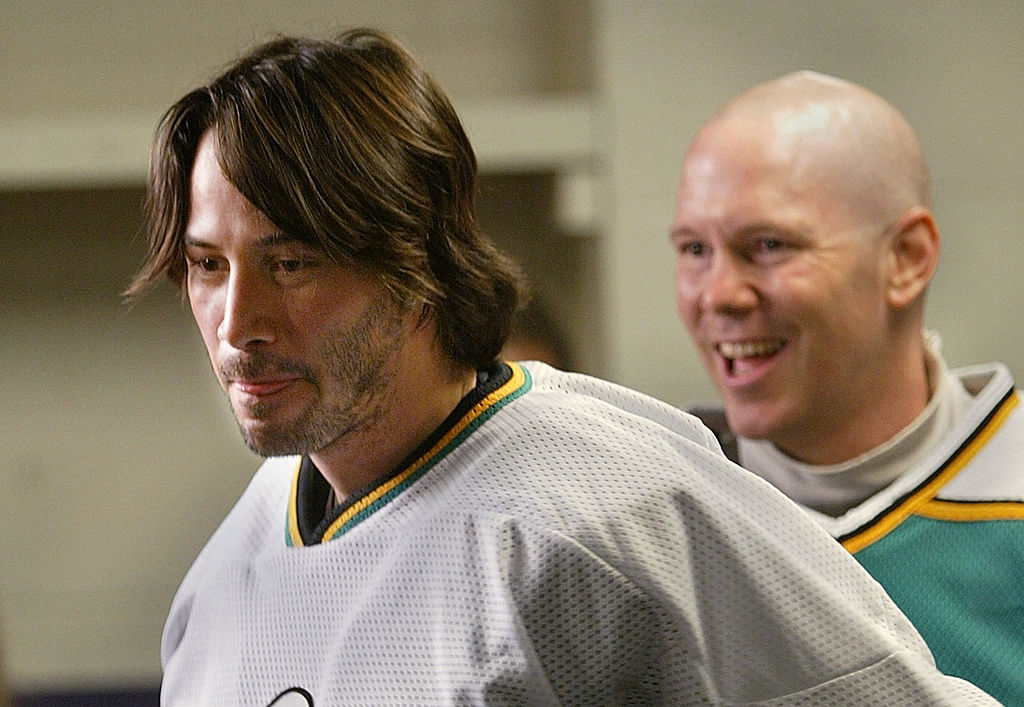 Keanu Reeves in hockey gear for a celebrity game.