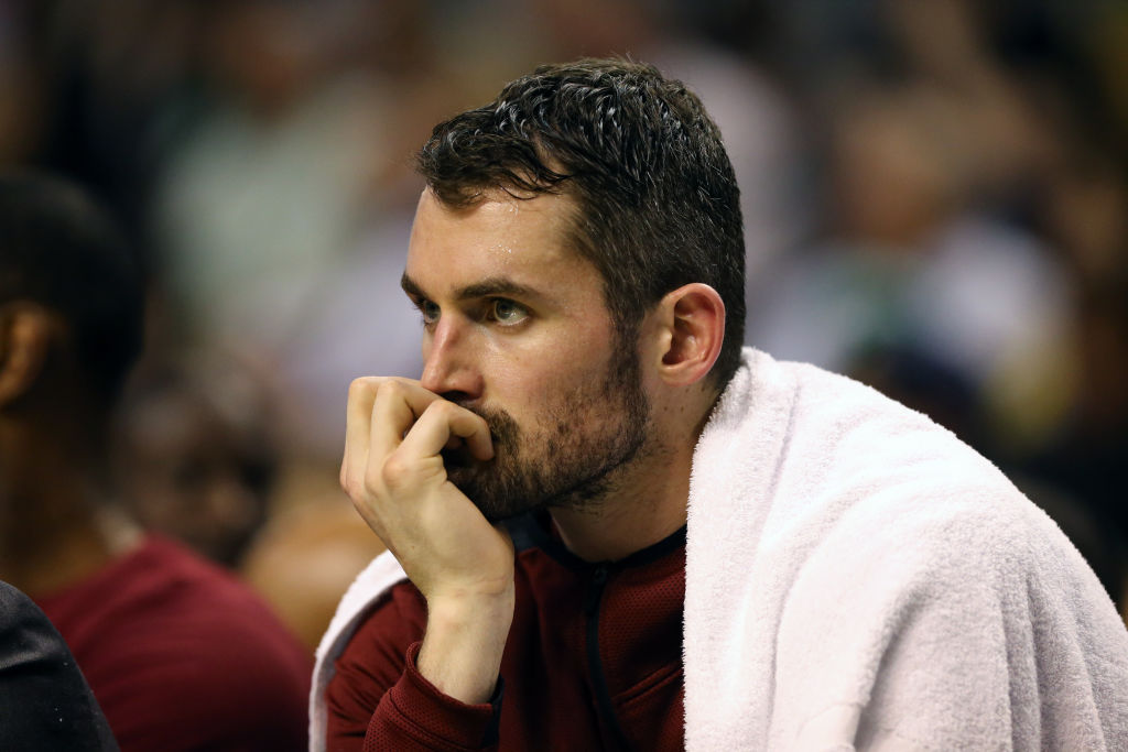 Kevin Love of the Cleveland Cavaliers reacts from the bench