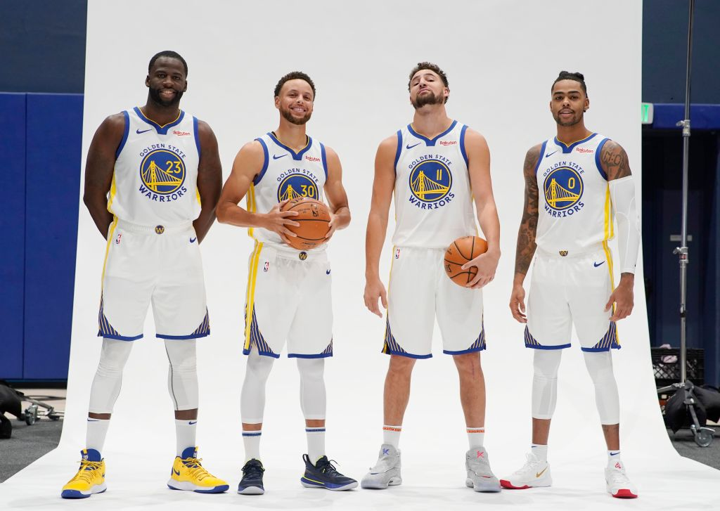 Stephen Curry (second from left) and D'Angelo Russell (right) comprise one of the best backcourt duos in the NBA.