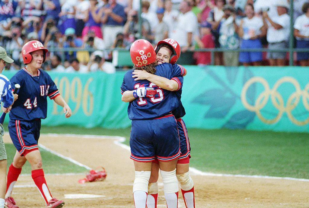 Third baseman Lisa Fernandez hugs U.S. softball captain Dot Richardson after Richardson hit the gold medal game-winning home run at the 1996 Atlanta Olympic Games