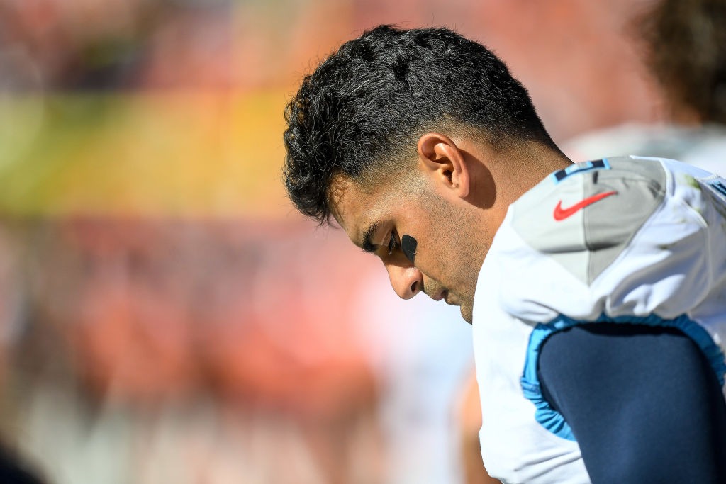 Marcus Mariota #8 of the Tennessee Titans stands in the bench