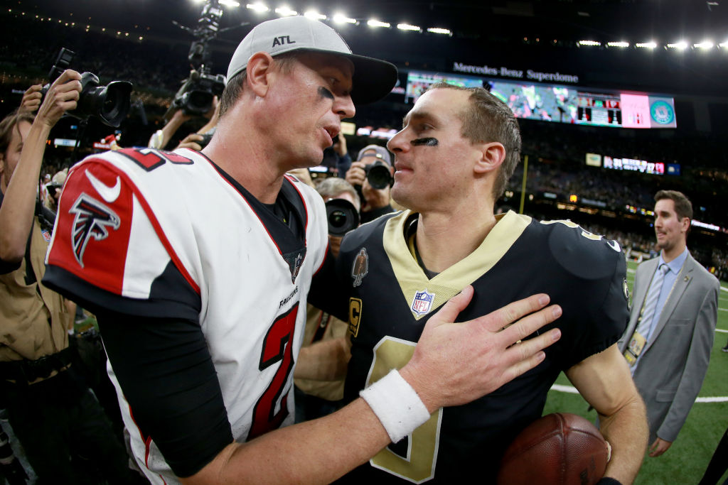 Matt Ryan of the Atlanta Falcons and Drew Brees of the New Orleans Saints shake hands