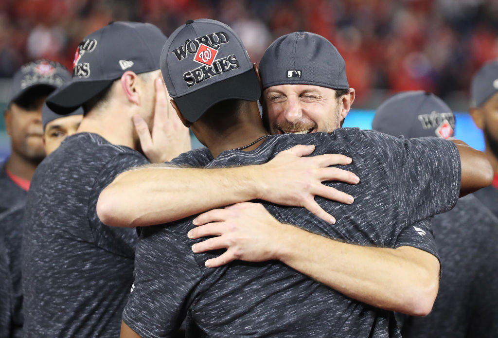 Max Scherzer #31 of the Washington Nationals celebrates winning game four