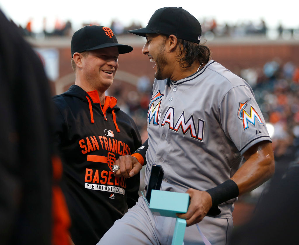 Miami Marlins' Michael Morse and former San Francisco Giants player jokes with Giants pitcher Matt Cain after he received his 2014 World Series ring