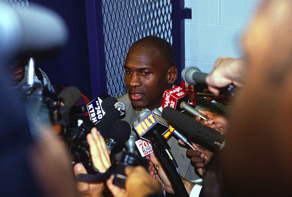 Michael Jordan of the Chicago Bulls talks with the media