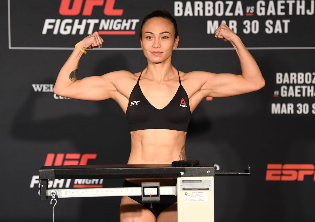 Michelle Waterson poses on the scale during the UFC Fight Night weigh-in