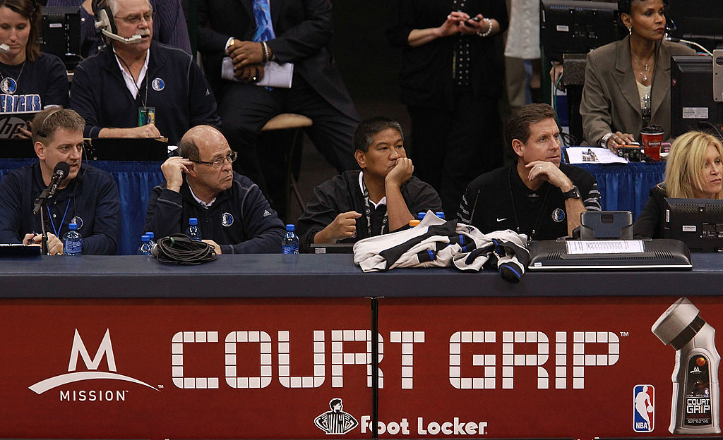 An NBA clock operator sitting at the scorers table.