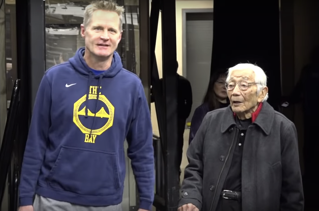Warriors coach Steve Kerr speaks with former NBA player Wataru Misaka