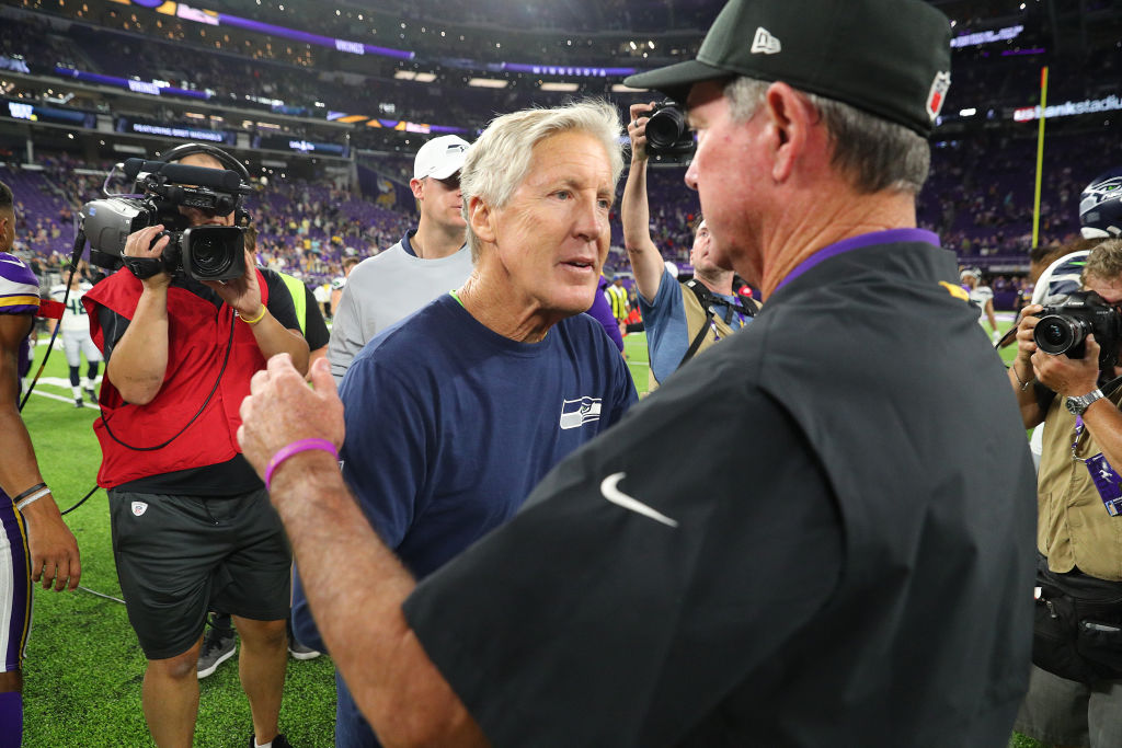 Head coach Pete Carroll of the Seattle Seahawks and head coach Mike Zimmer of the Minnesota Vikings