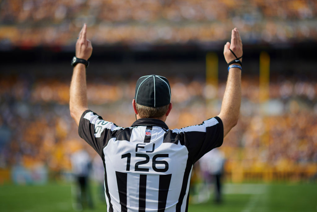 An NFL referee gives a touchdown signal