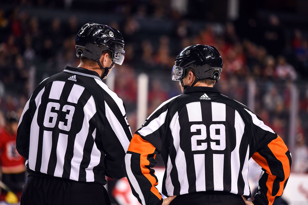 NHL Referees Trent Knorr (63) and Referee Ian Walsh (29)