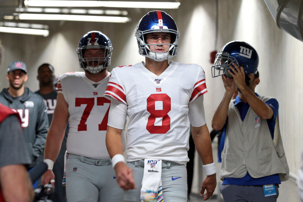 New York Giants quarterback Daniel Jones head to the field