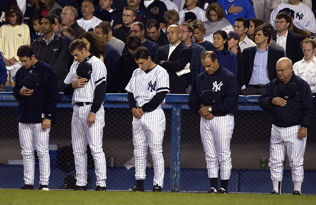 On the one year anniversary of September 11, 2001, members of the New York Yankees bow their heads to observe a moment of silence