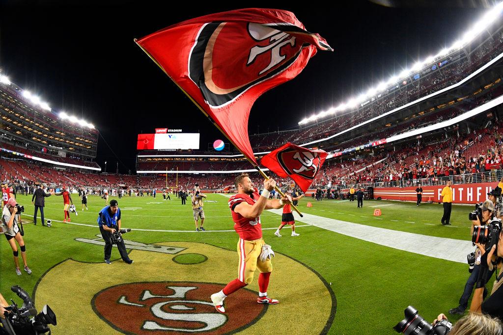 San Francisco 49ers Defensive End Nick Bosa (97) waves the flag