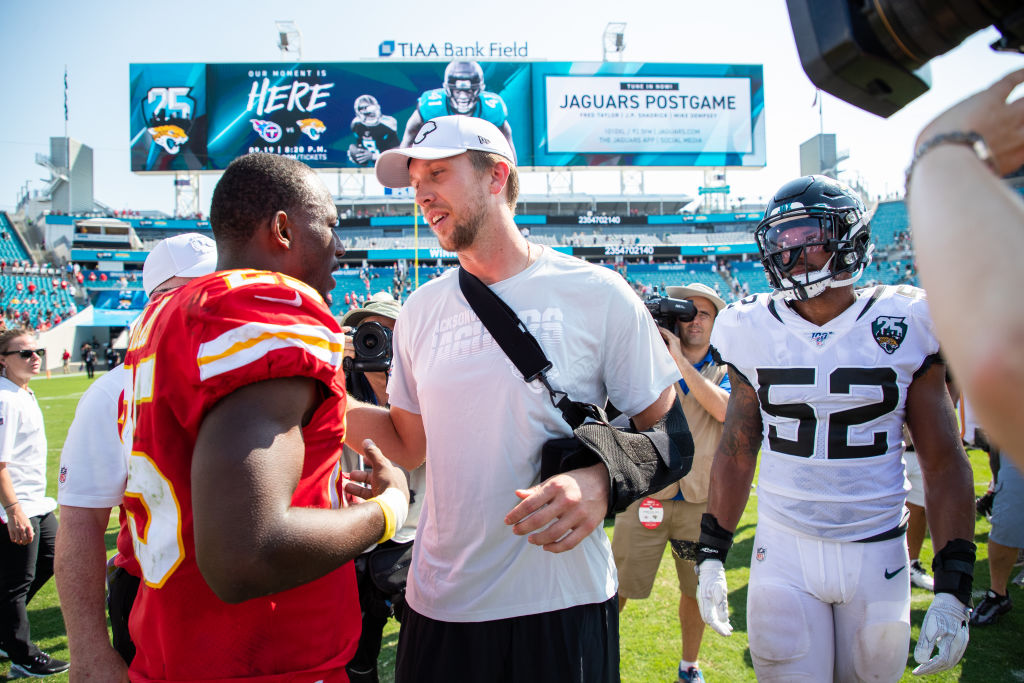 Nick Foles of the Jacksonville Jaguars meets with LeSean McCoy of the Kansas City Chiefs