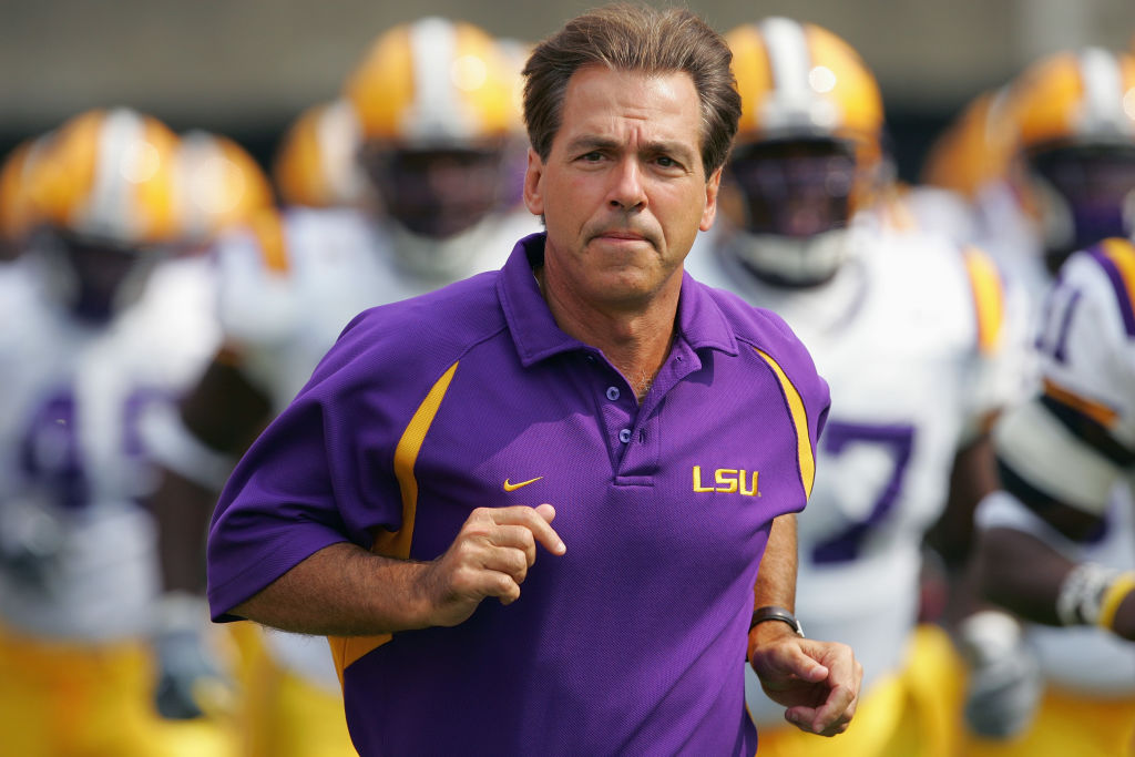Nick Saban as coach of LSU, jogging onto the field.