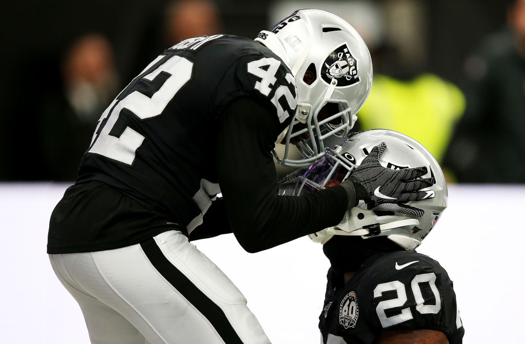 Two Oakland Raiders' players celebrate.