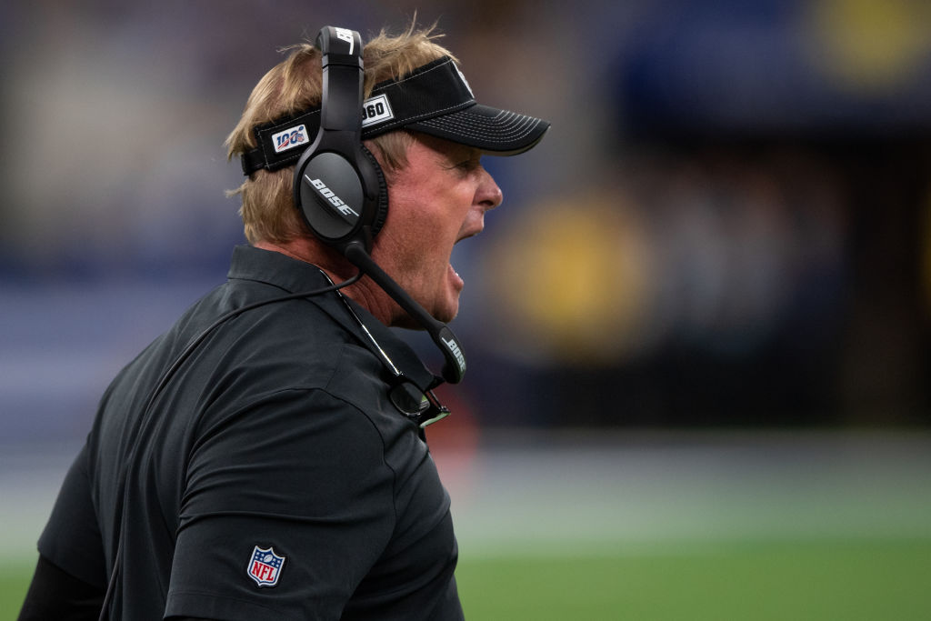 Former Oakland Raiders head coach Jon Gruden yells from the sidelines