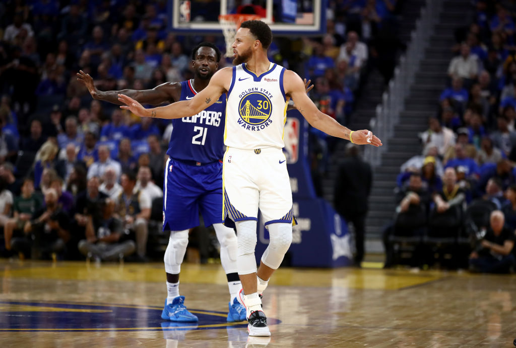 Clippers guard Patrick Beverley and Warriors guard Stephen Curry