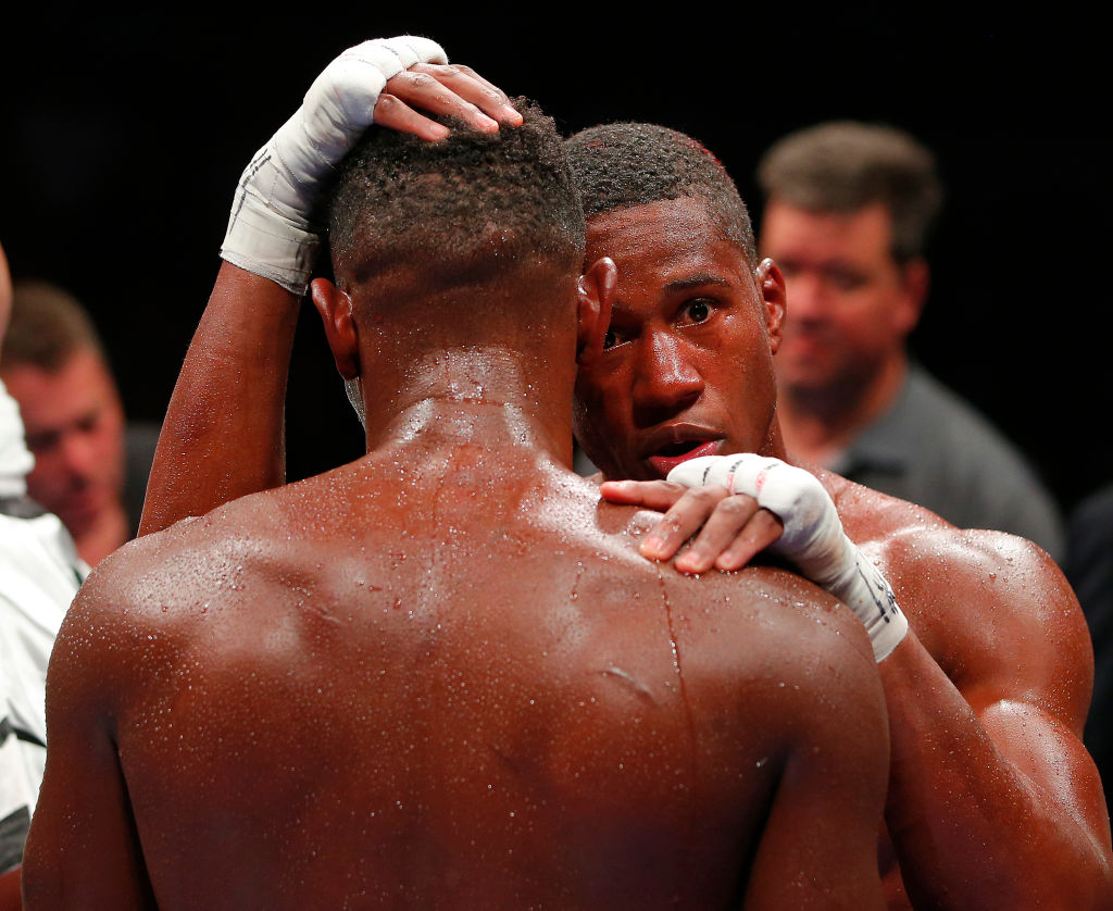 Patrick Day (R) hugs Eric Walker after his unanimous decision for the 2017 WBC Continental Americas Jr. Middleweight championship