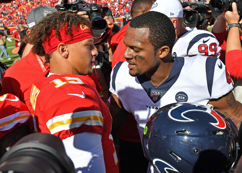 Quarterback Deshaun Watson #4 of the Houston Texans talks with quarterback Patrick Mahomes #15 of the Kansas City Chiefs