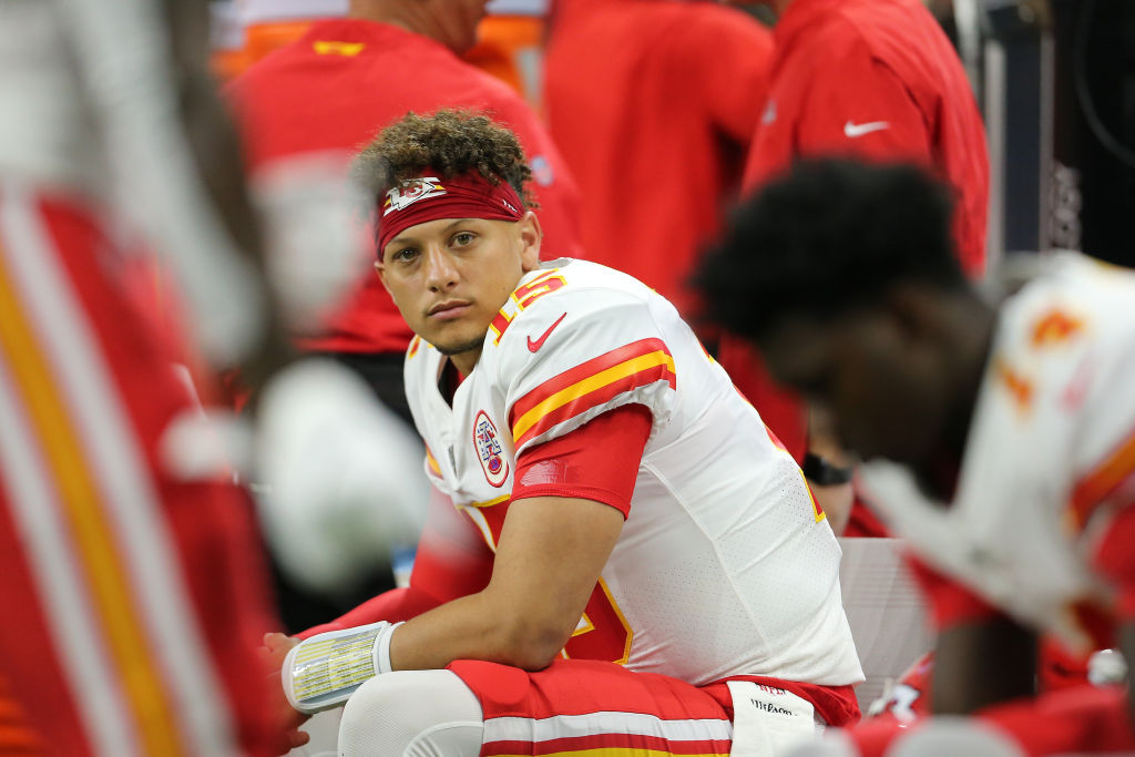 Patrick Mahomes of the Kansas City Chiefs looks on from the bench